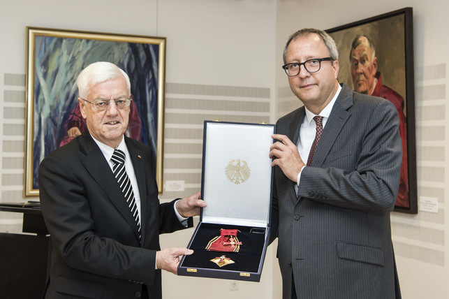 The President of the Constitutional Court of Austria Receives the Grand Cross of the Order of Merit of the Federal Republic of Germany